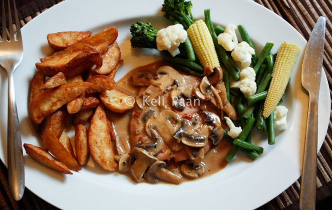 Smoked gammon steak in a spicy mushroom sauce
