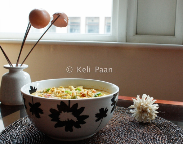 Milky Egg curry with capsicum garnishing