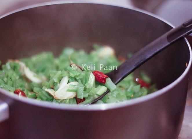 Stir fry the beans till done..