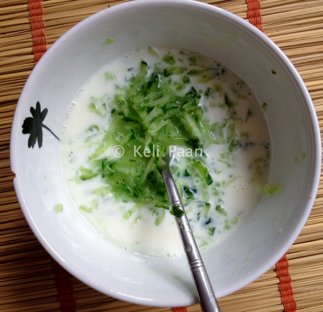 Add the grated cucumber to the yogurt-milk mixture..
