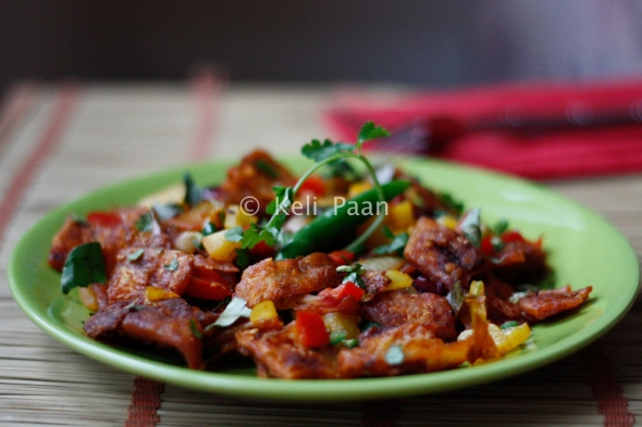 Chilly Kothu Parota/Bite sized Paratha pieces tossed in a hot & spicy sauce...