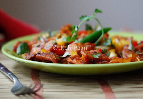 Chilly Kothu Parota/Bite sized Paratha pieces tossed in a hot & spicy sauce