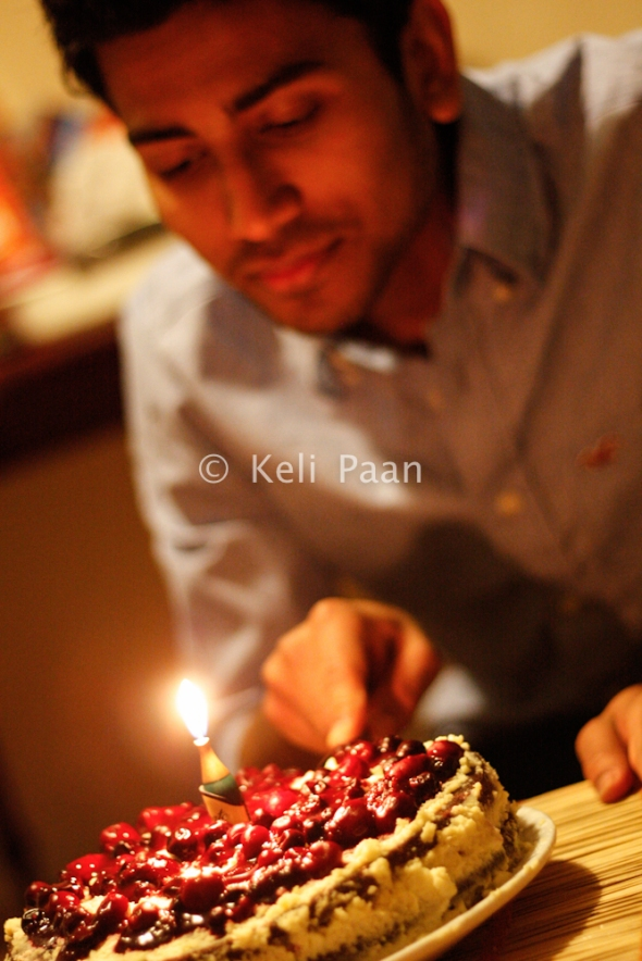 The bday boy cutting his cake..!