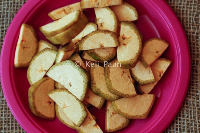 Raw plantains peeled & cut into semicircular pieces..