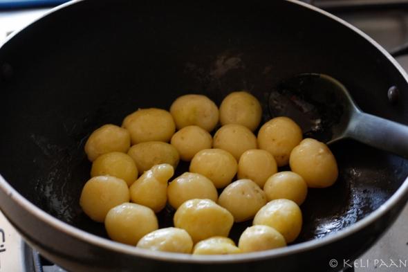 Fry the baby potatoes till golden brown..
